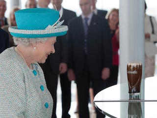 This is a photo of the Queen Elizabeth 2 in front of a Guinness beer in the Guinness Store